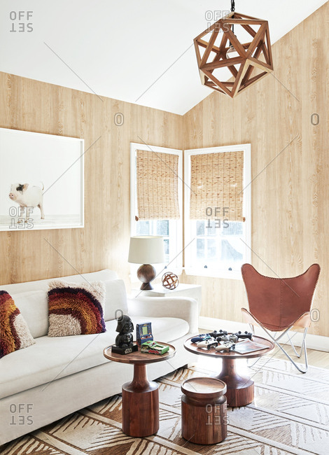 Los Angeles, California - May 31, 2019: Living room interior with wooden walls and video game controllers on table