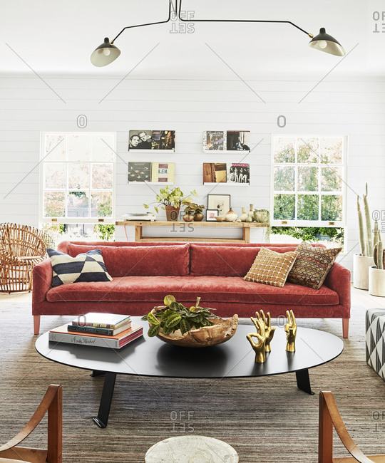 Los Angeles, California - May 31, 2019: Interior of a home with red sofa and shiplap wall