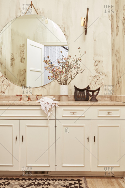Upscale bathroom with marble vanity and copper faucet