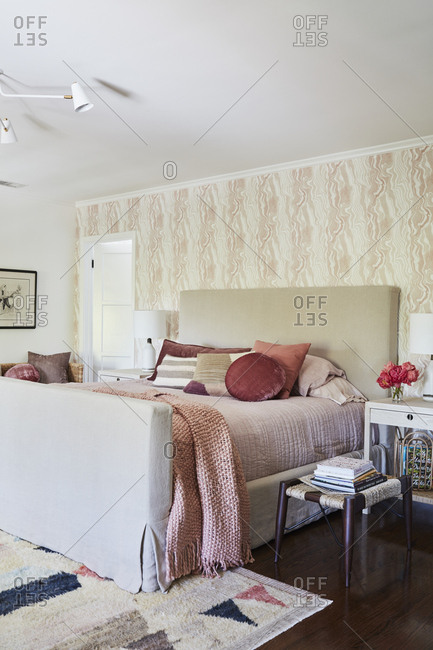 Los Angeles, California - May 17, 2019: Bedroom interior with a large bed and pink linens