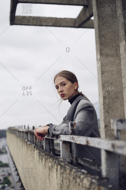 woman on the roof of a building