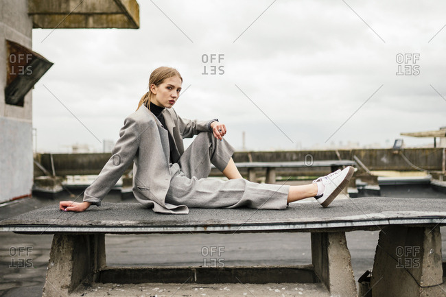 woman sitting on the roof of a building