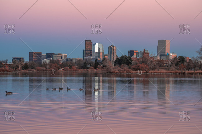 Denver, Colorado, United States - November 21, 2018: Denver skyline as seen from the Sloan Lake at sunset