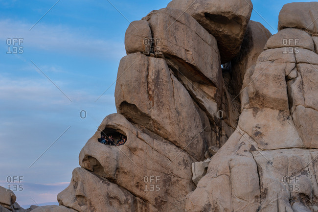 United States, California, Joshua Tree - March 26, 2019: Climbers Enjoy Sunset in A Rock Formation In Joshua Tree National Park