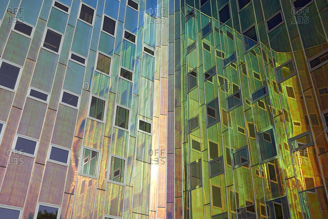 Amazing colorful reflective facade of a modern office building in sun