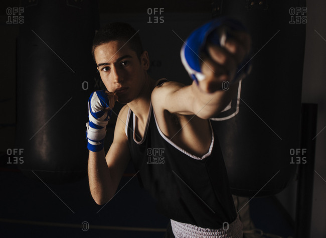 Young boxer practicing the left jab movement.