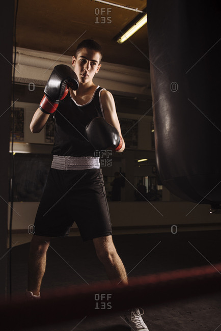 Young man boxer ready to practicing boxing with punching bag.