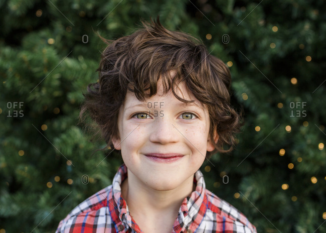 portrait of a small happy child gazing directly at camera