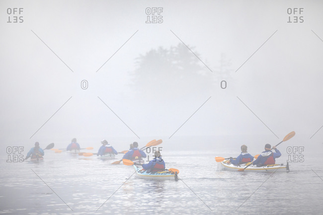 Telegraph Cove, British Columbia, Canada - August 23, 2019: Kayak group paddling in foggy morning