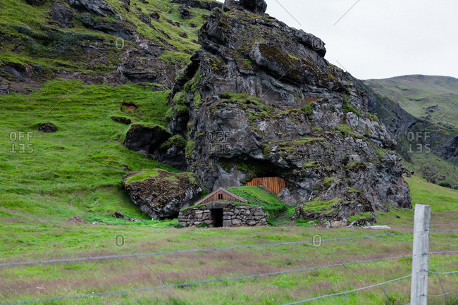 Grass roof house built into hillside in rural Iceland
