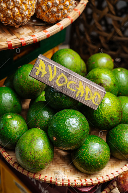 Ripe green avocados for sale in a market