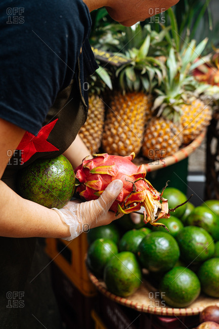 Woman picking fruit from a market
