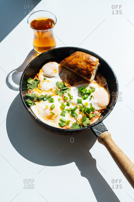 Fried eggs in a skillet with bread