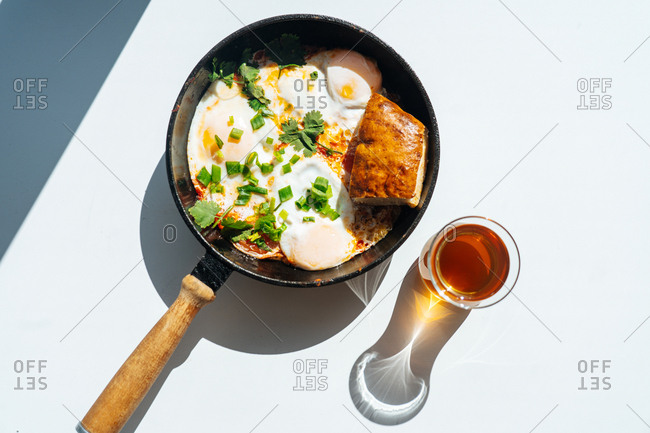 Fried eggs in a frying pan with bread