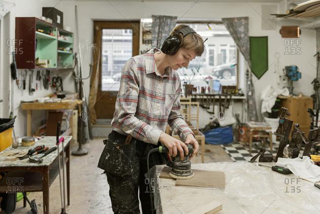 Carpenter sanding wood - Offset Collection