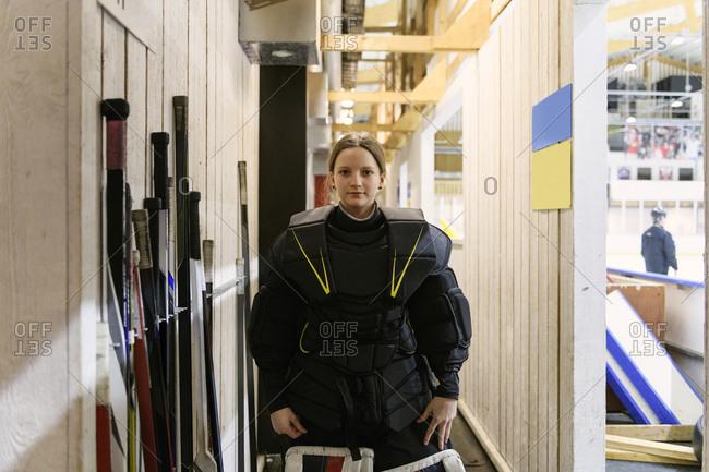Girl in ice hockey uniform