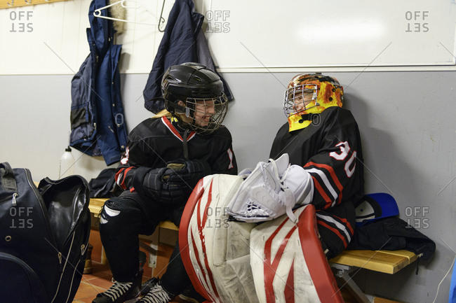 Girls in changing room prepare for ice hockey training
