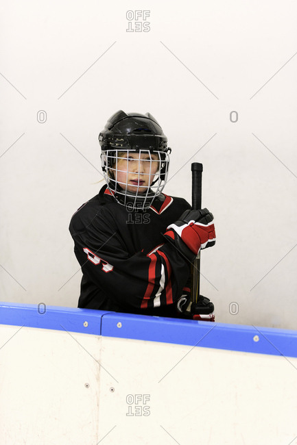 Girl in ice hockey uniform