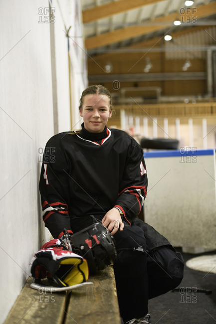 Girl in ice hockey uniform during training