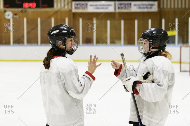 Girls on ice rink for ice hockey training