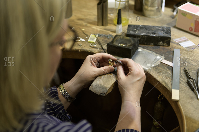 Goldsmith working on ring