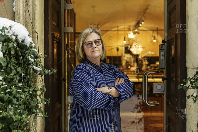 Goldsmith standing in doorway of her store