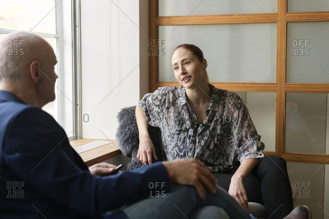 Businesspeople talking in office
