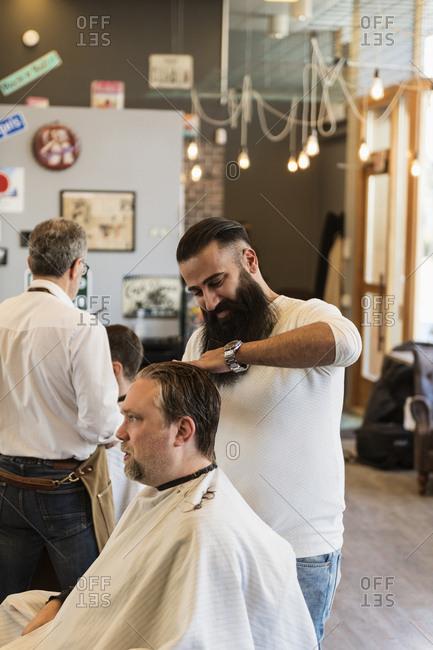 Barber cutting customer�s hair
