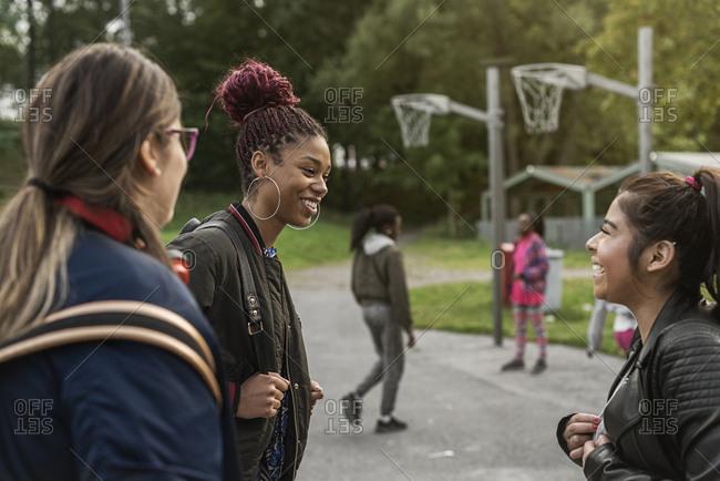 Teenage girls smiling in park