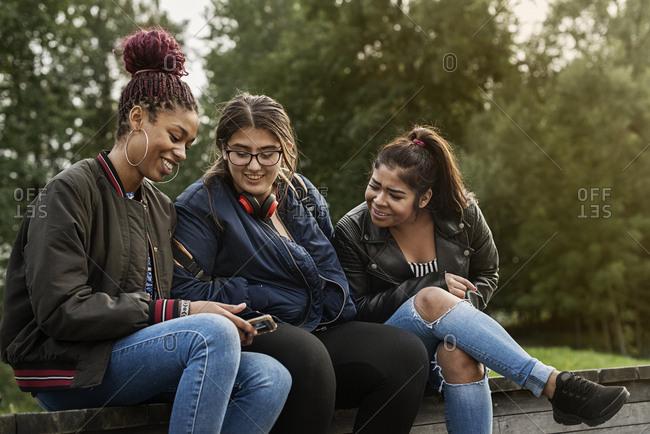 Teenage girls using smart phone