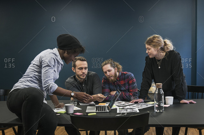 Coworkers looking at laptop