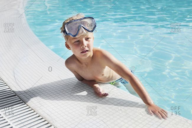 Boy wearing goggles in pool