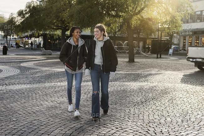 Teenage girls walking on cobblestone