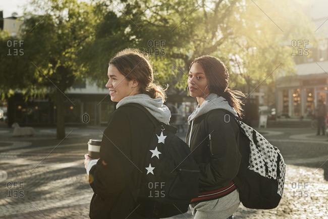 Teenage girls wearing backpacks