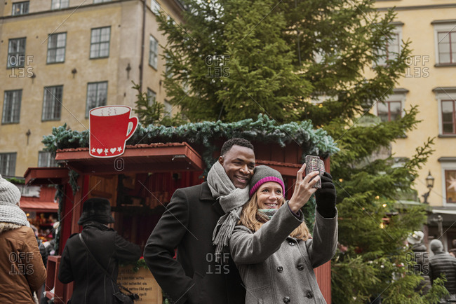Couple taking selfie Christmas Fair
