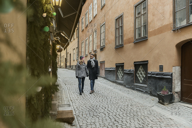 Couple holding hands on street in Stockholm, Sweden