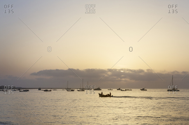 October 26, 2017: Boats on the sea at sunset in Cape Verde