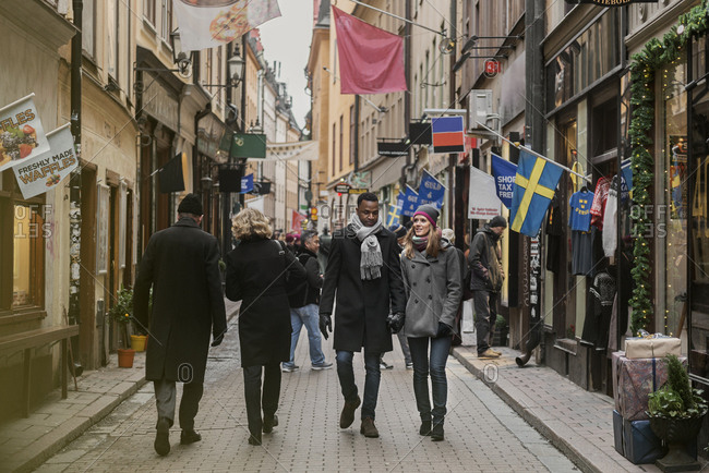 December 19, 2017: Couple holding hands on street in Stockholm, Sweden