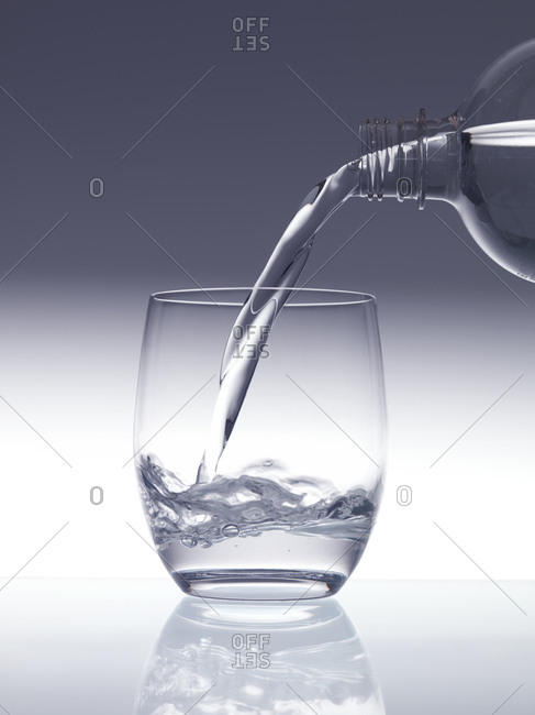 Clean drinking water being poured into a glass.
