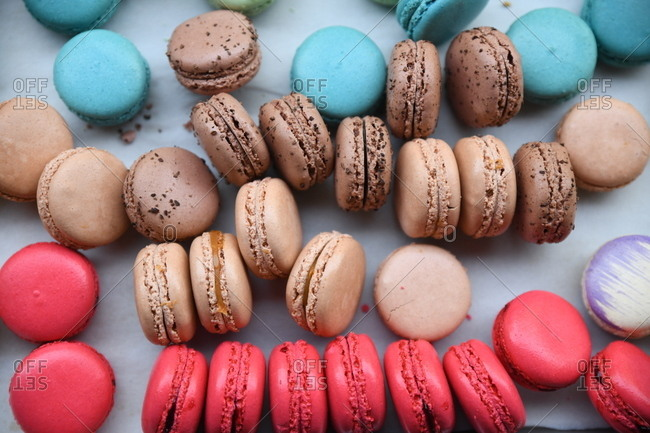 Colorful macaron cookies on white surface