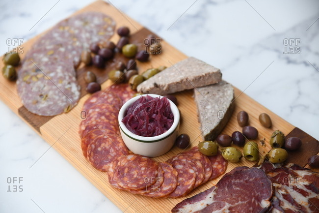 Charcuterie board appetizer on light surface