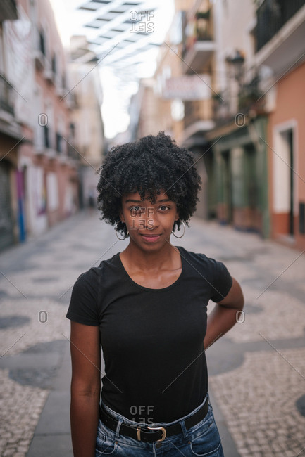 Young black woman with afro hair in the city