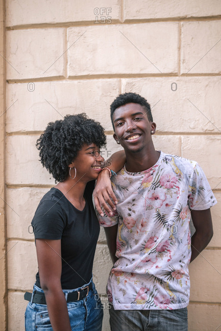 Young black teenager couple smiling in the city