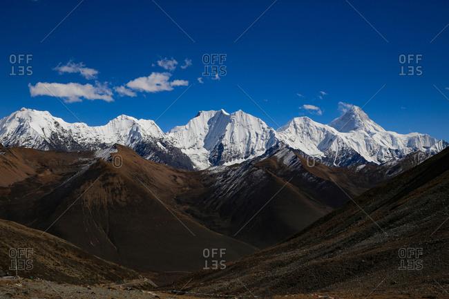 Sichuan xindu bridge snow mountain
