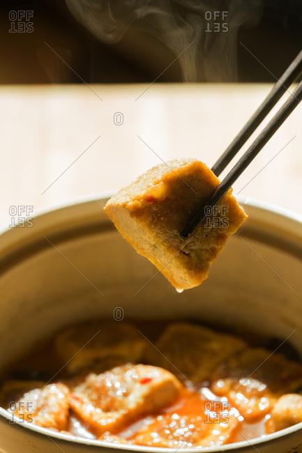Eating stuffed tofu