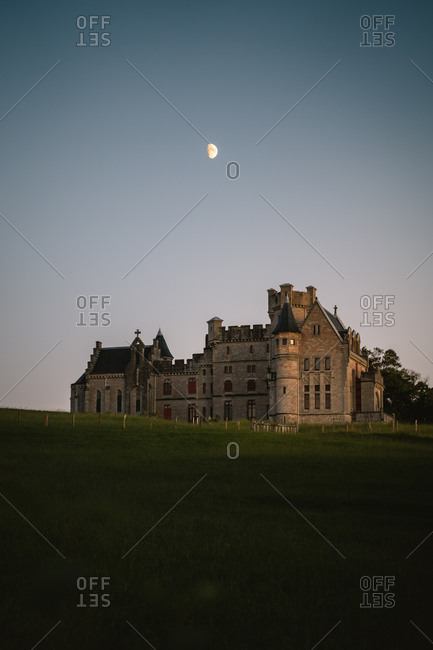 Sunset view of the 19th century chateau of Hendaye with  crescent moon rising