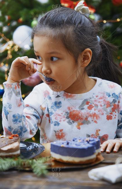 Girl eating gluten and casein free Christmas cake