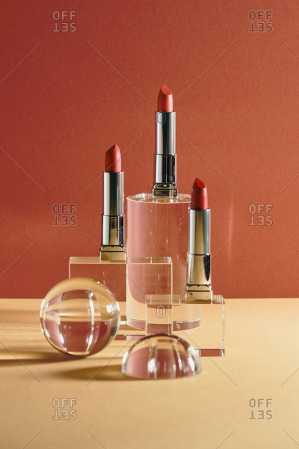 Lipsticks of various colors. Beauty concept on light background.