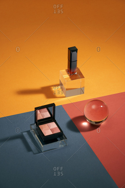 Set of eyeshadows, lipstick. Fashion woman still life. On color background