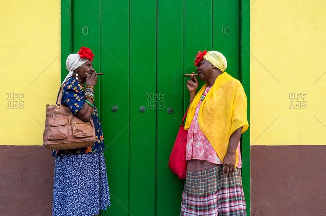Old school Cuban ladies smoking a large cigar in Havana, Cuba